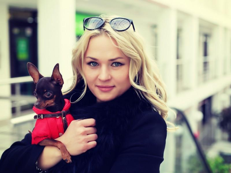 Stylish woman with her dog.