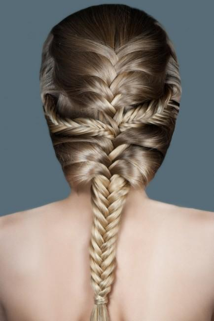 Woman with a beautiful braided hairstyle.