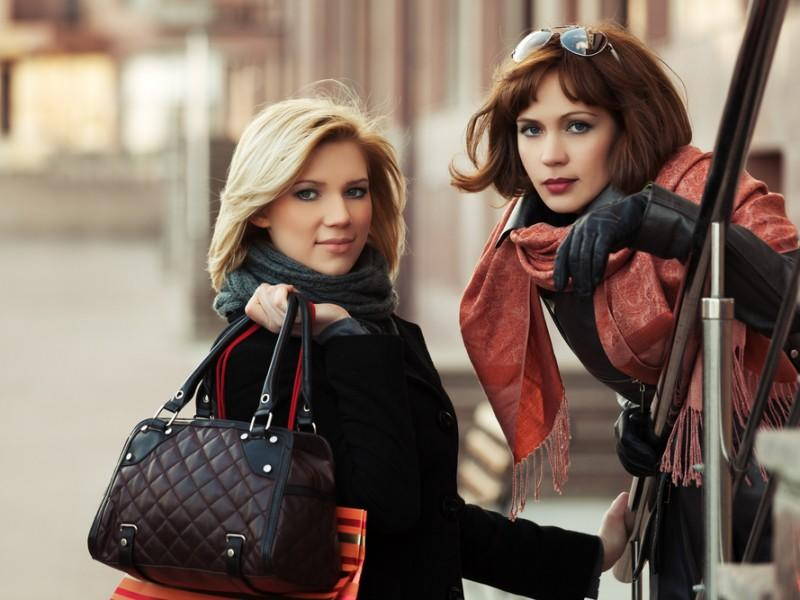 Fashionable women with handbags.