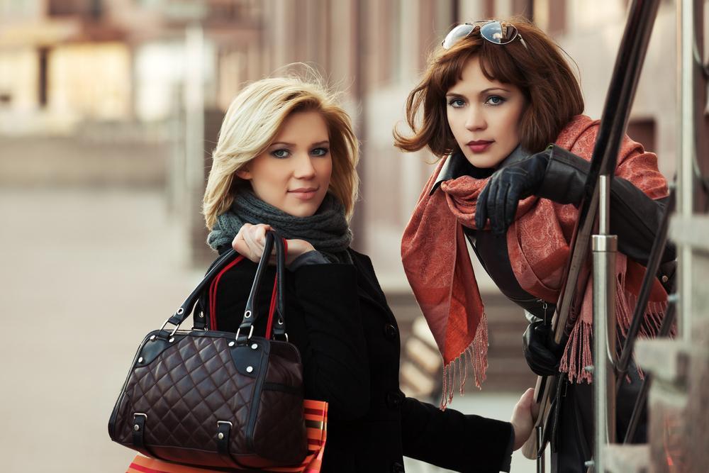 Fashionable women with handbags.