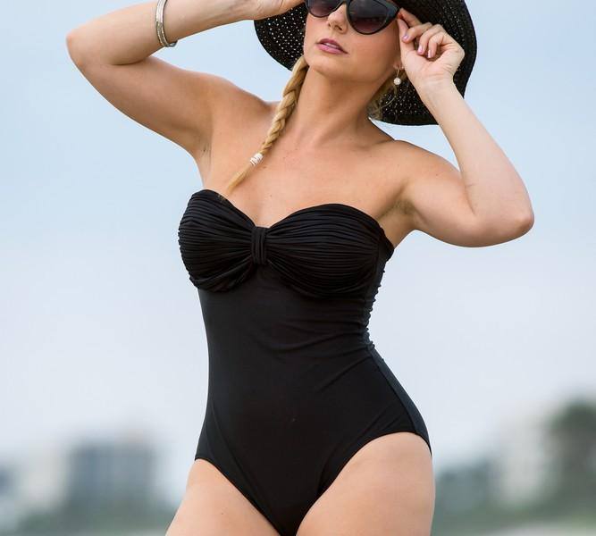 Fashionable woman in a one-piece swimsuit.