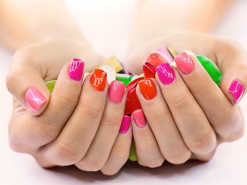 Woman showing off her beautiful nail art.