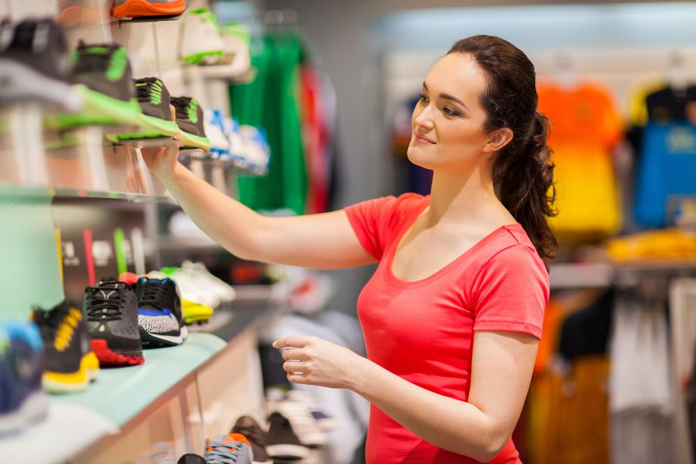Woman purchasing sneakers from a shoe store