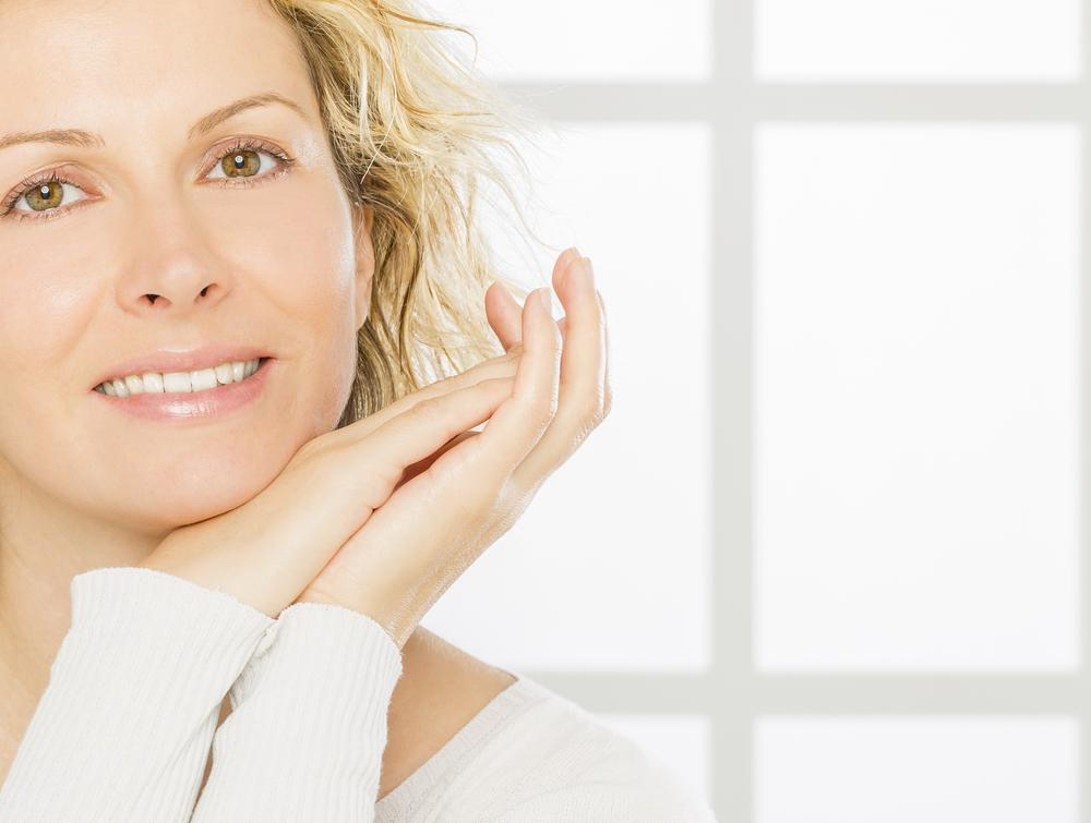 Woman in her forties with beautiful skin. Skin Care concept.
