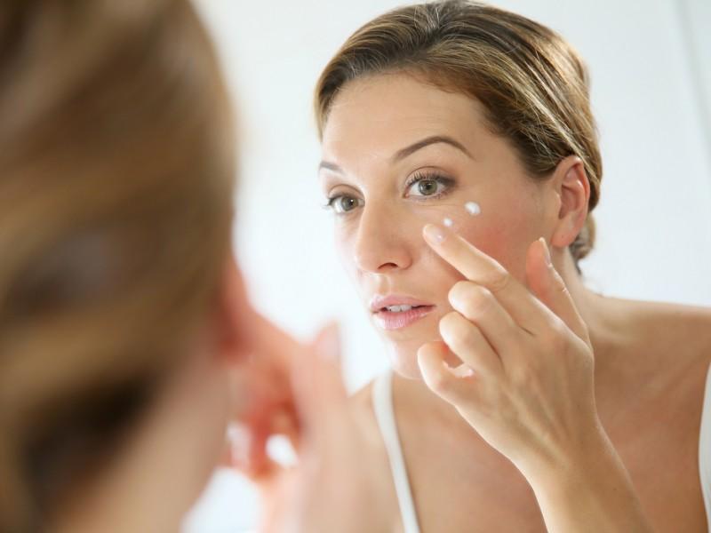 Woman applying anti-aging wrinkle cream