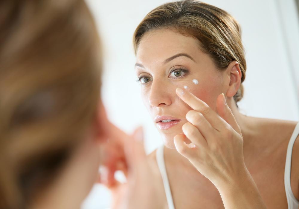 Woman applying anti-aging wrinkle cream