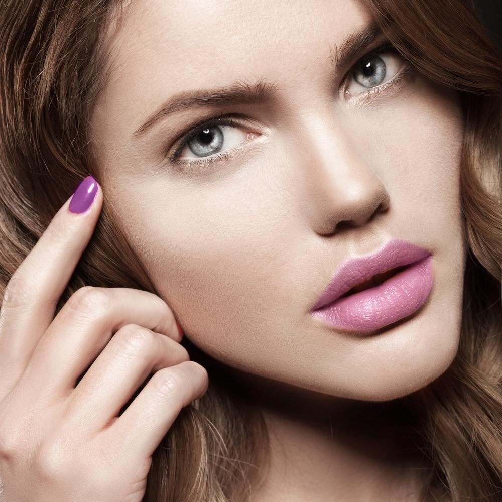 Woman with beautiful eyebrows and pink makeup.