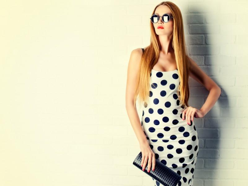 Fashionable woman wearing a polka dotted dress.