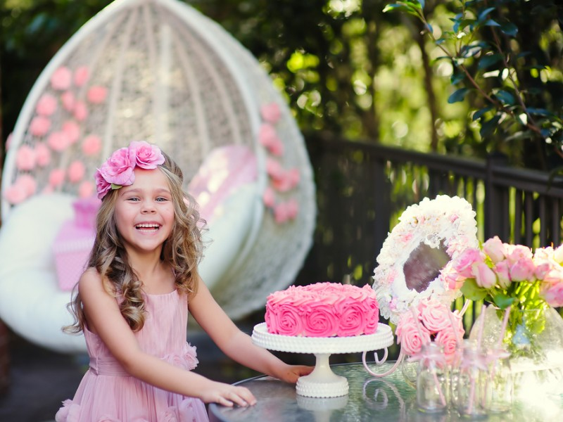 Little girl enjoying a pink themed birthday party