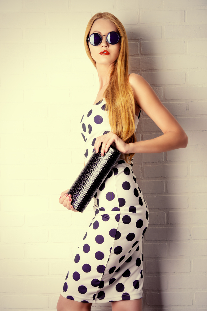 Polka dot dress with clutch