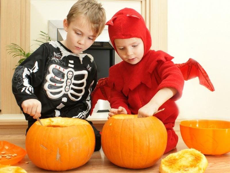 Young kids preparing for Halloween.