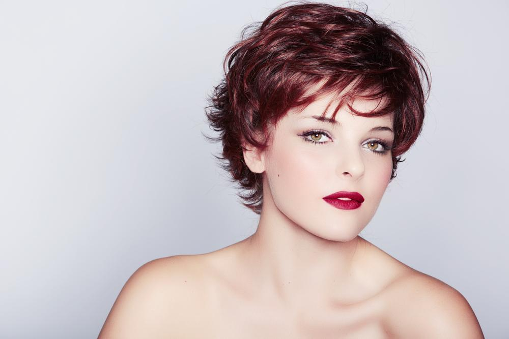 Woman in a pixie cut.