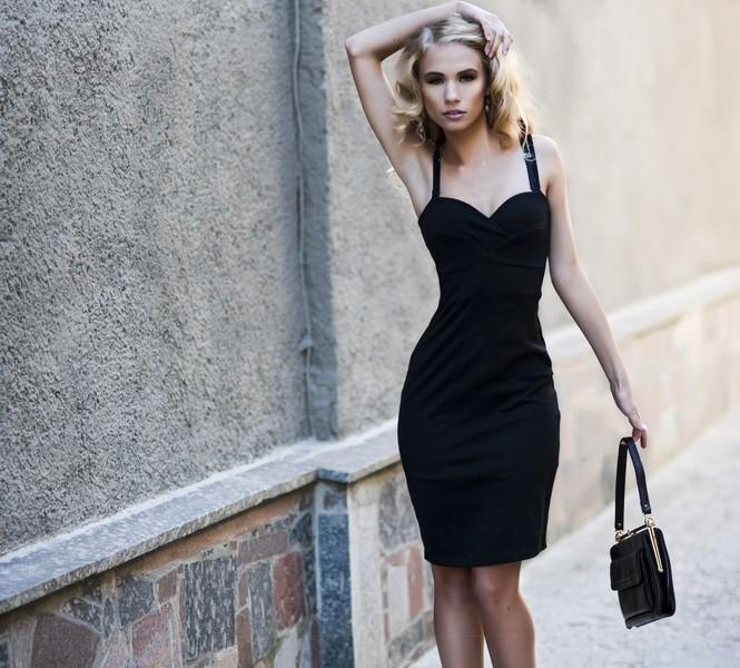 Woman in a sexy black dress.