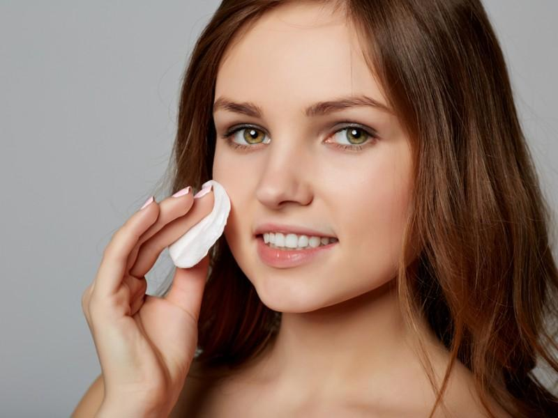 Woman cleansing makeup
