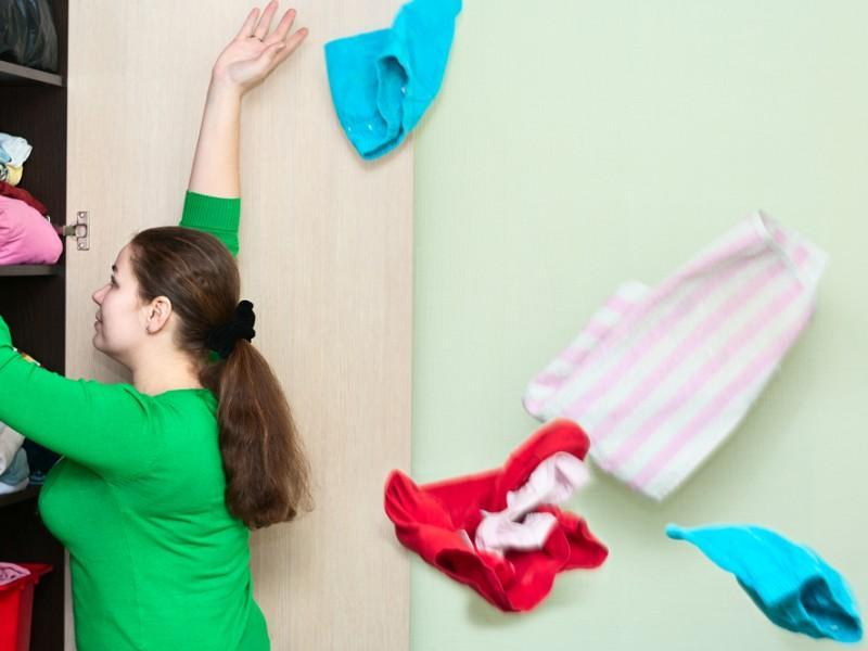 Woman throwing old clothes