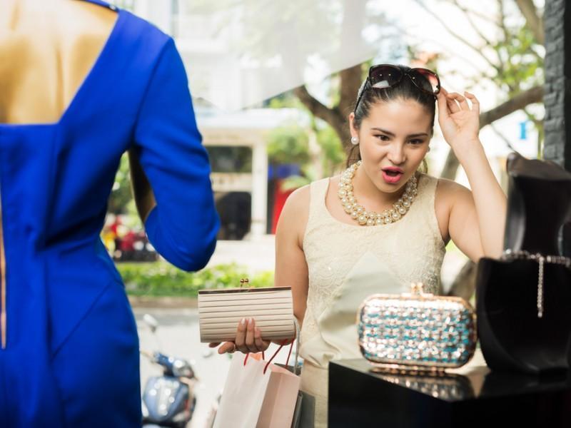 Woman looking at a wallet