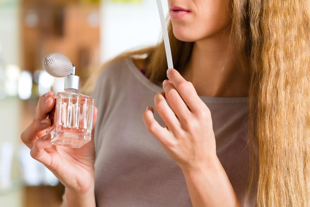 Woman buying a perfume