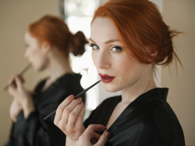 Woman applying lip liner