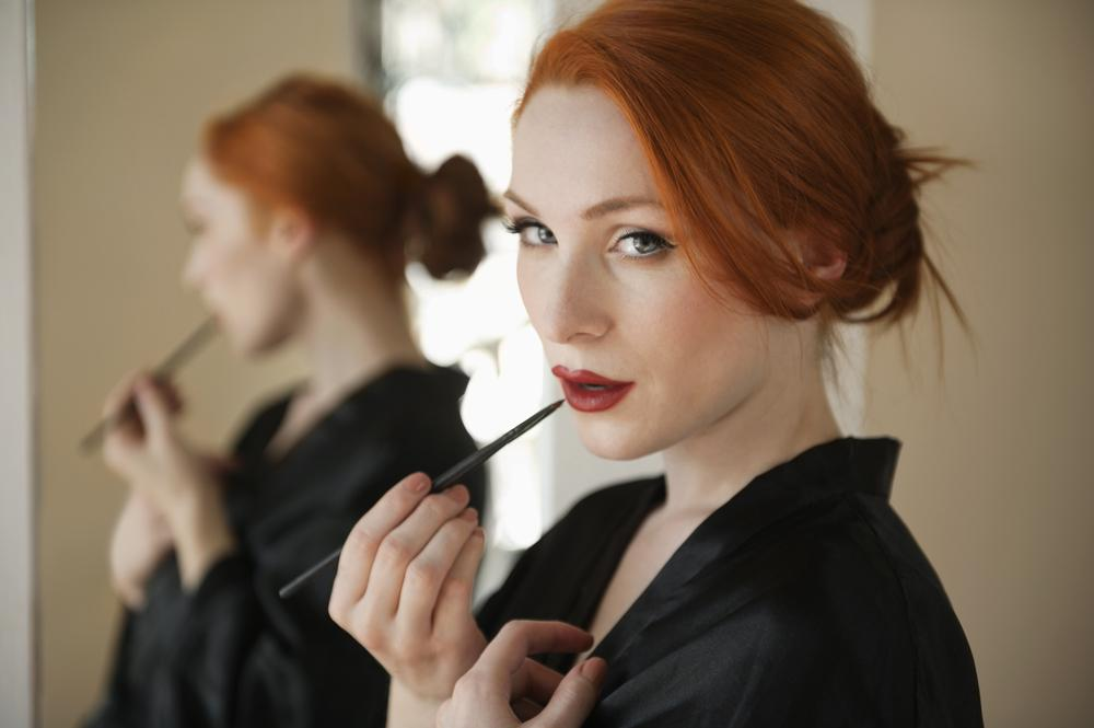 Woman applying lip liner