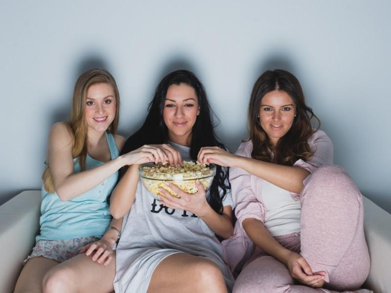 Friends watching a TV show