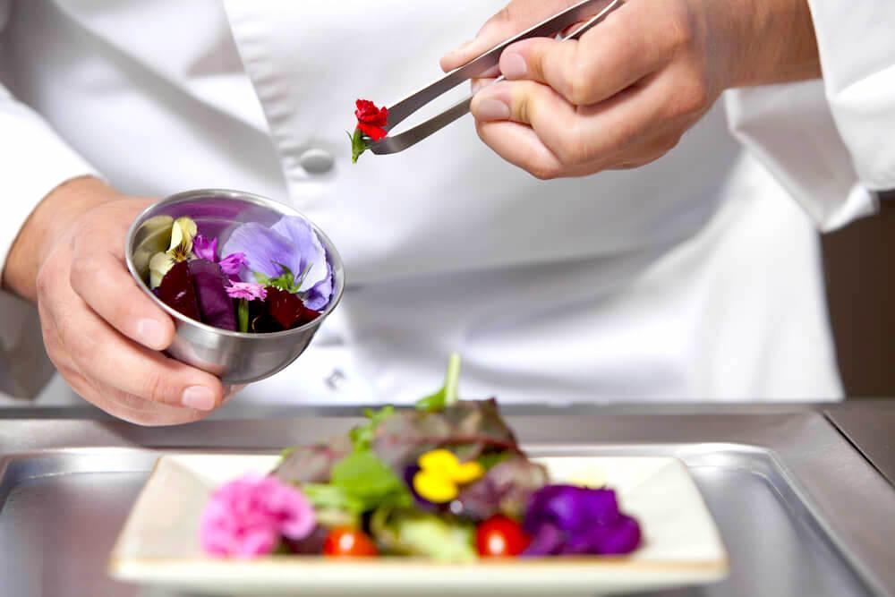 chef decorating with edible flowers