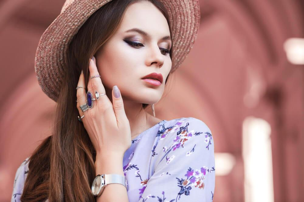 Young fashionable woman with rings on fingers and a watch