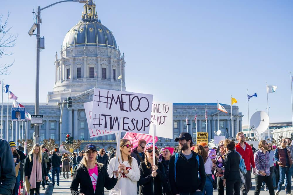 January 20, 2018 San Francisco / CA / USA - Women's March protesters begin to walk; #metoo and #timesup slogans written on a sign at the rally held in front of the City Hall