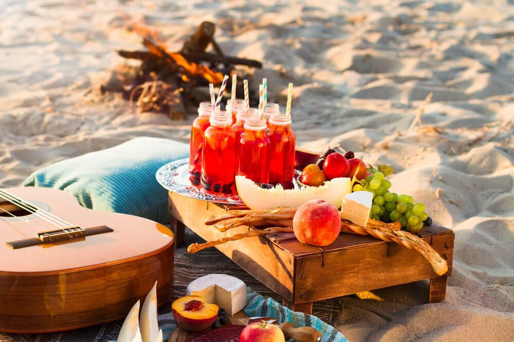 Drinks and fruit on a platter, beach picnic
