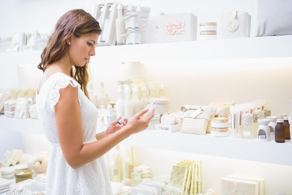 Woman looking at cosmetics in store