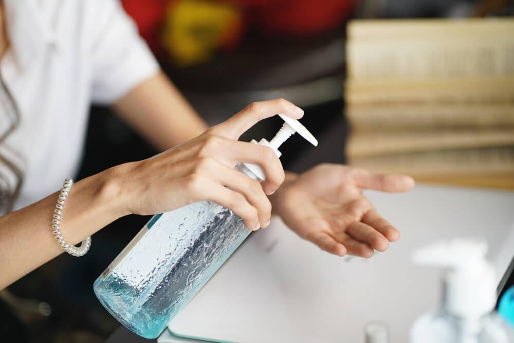 Woman using DIY hand sanitizer