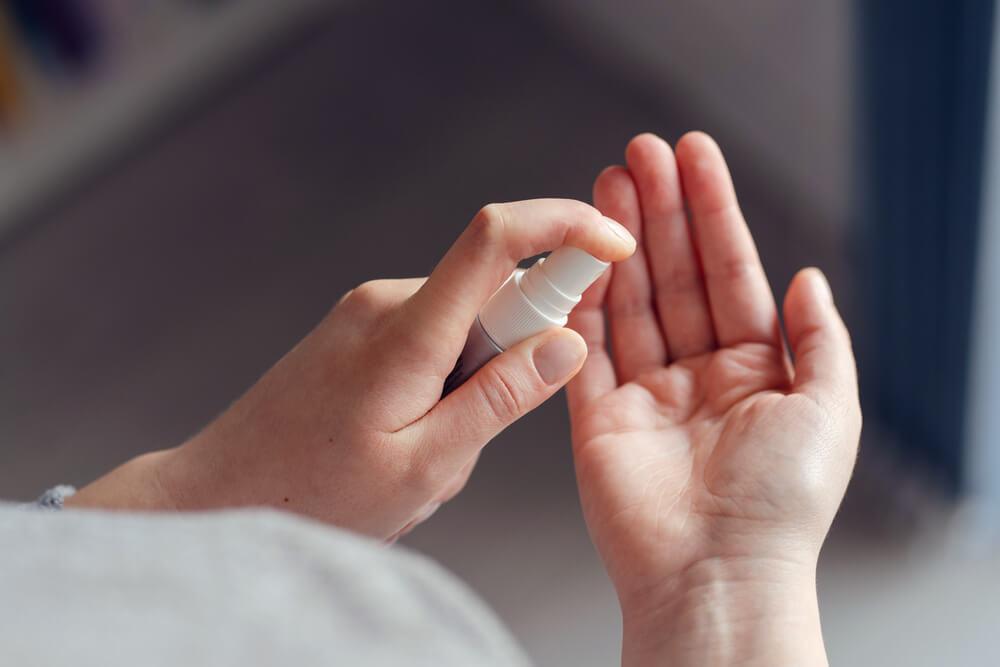 Hands using hand sanitizer