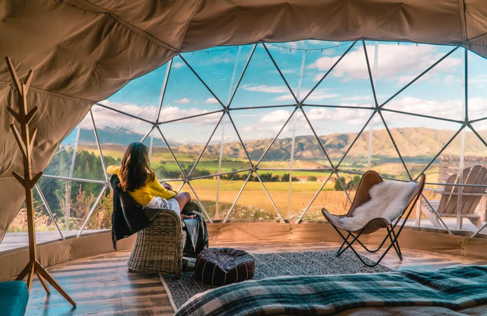 Woman in glamping tent