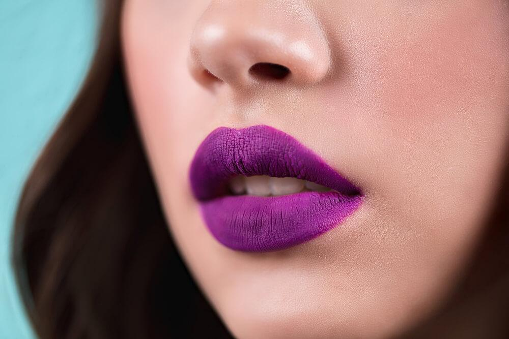 Lips with purple lipstick