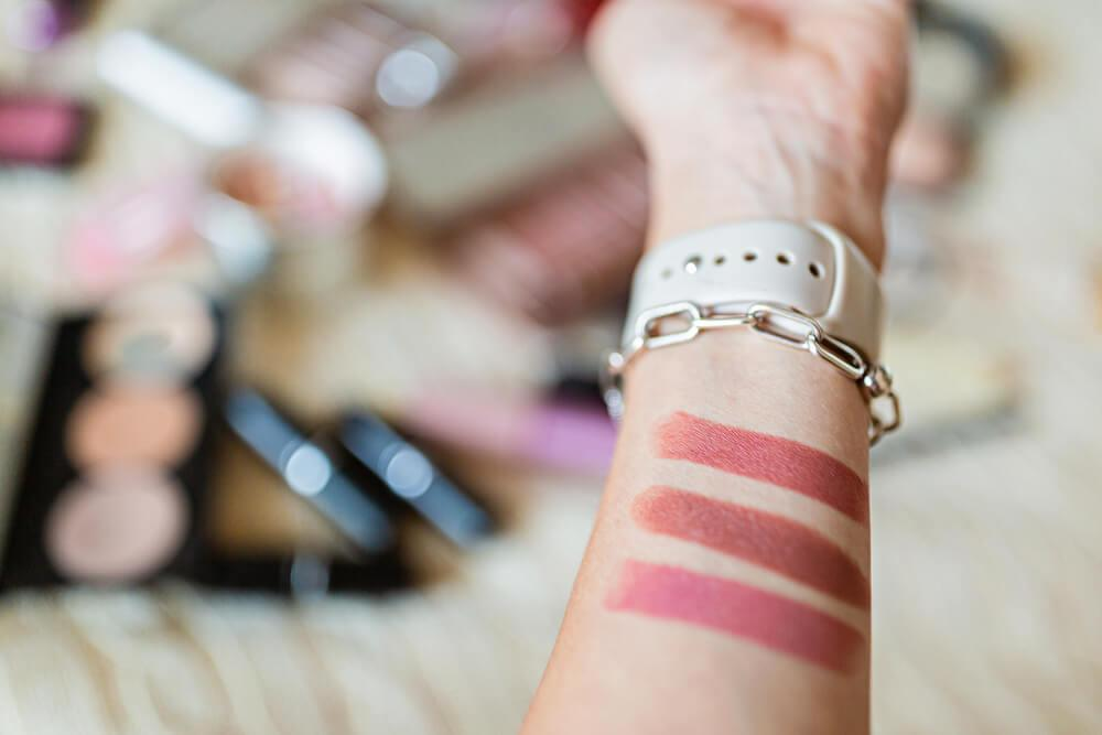 Lipstick swatches on wrist