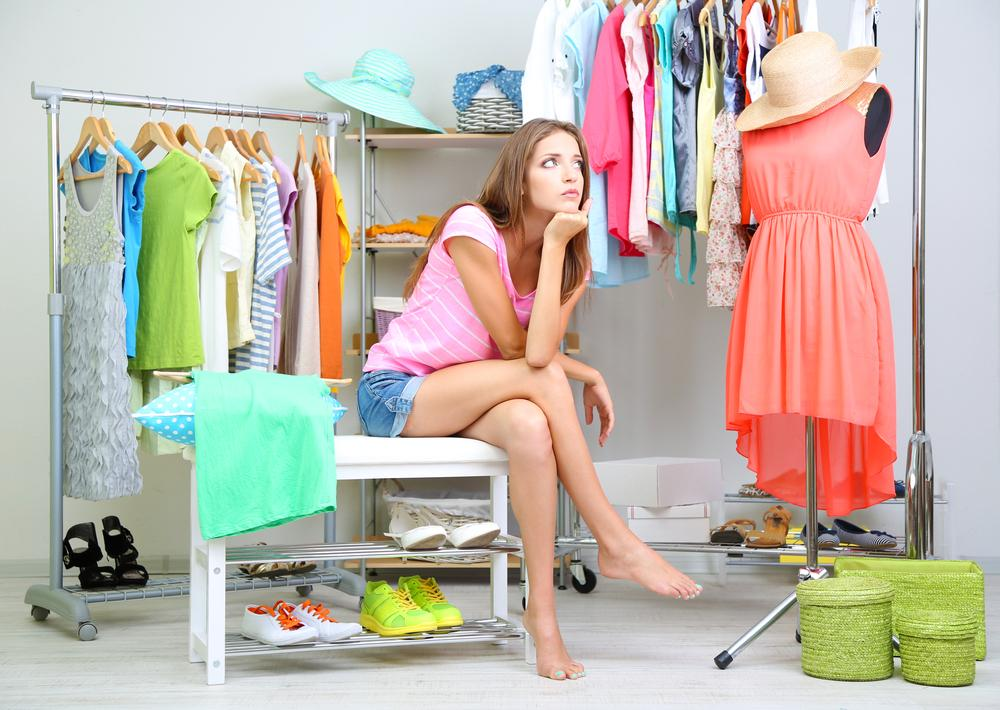 Woman thinking about what to wear.