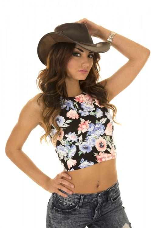 Woman wearing a floral crop top.