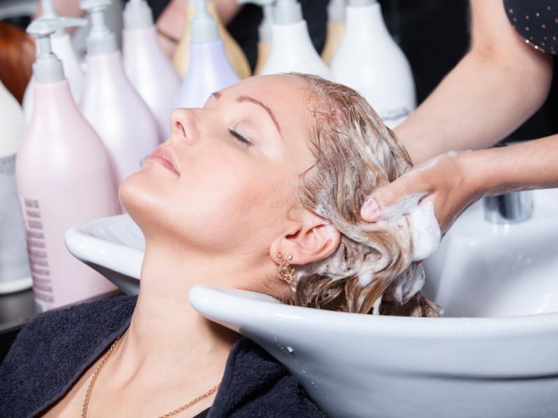 Woman getting a shampooq