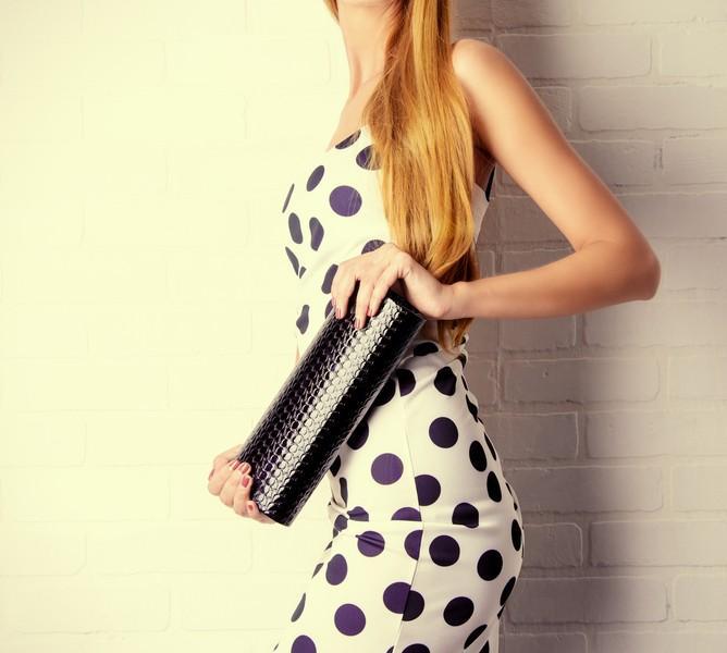 Polka dot dress with clutch