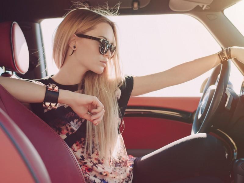 Woman driving a sports car.
