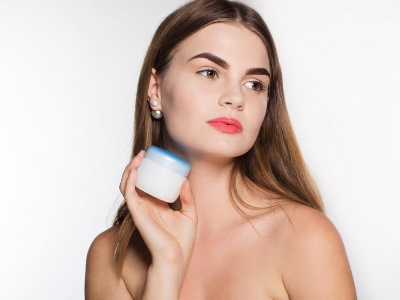 Woman holding a skin care product