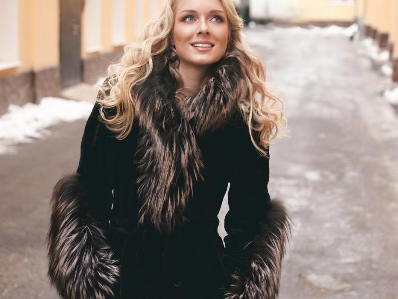 Woman wearing winter coat.