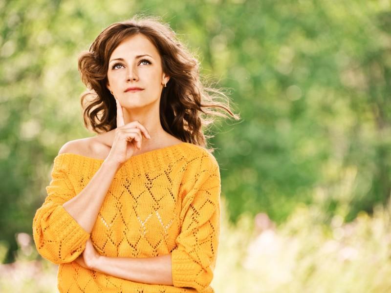Woman wearing orange jumper