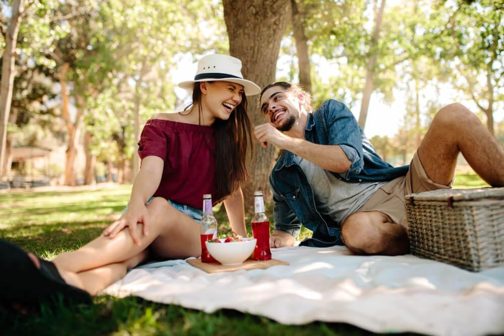 Couple enjoying picnic outdoors