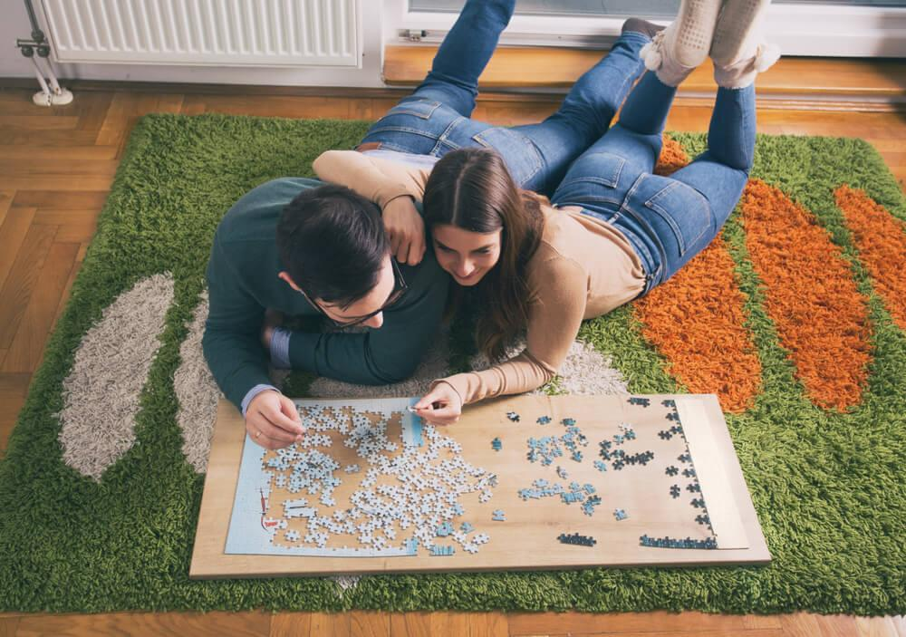 Couple doing jigsaw puzzle
