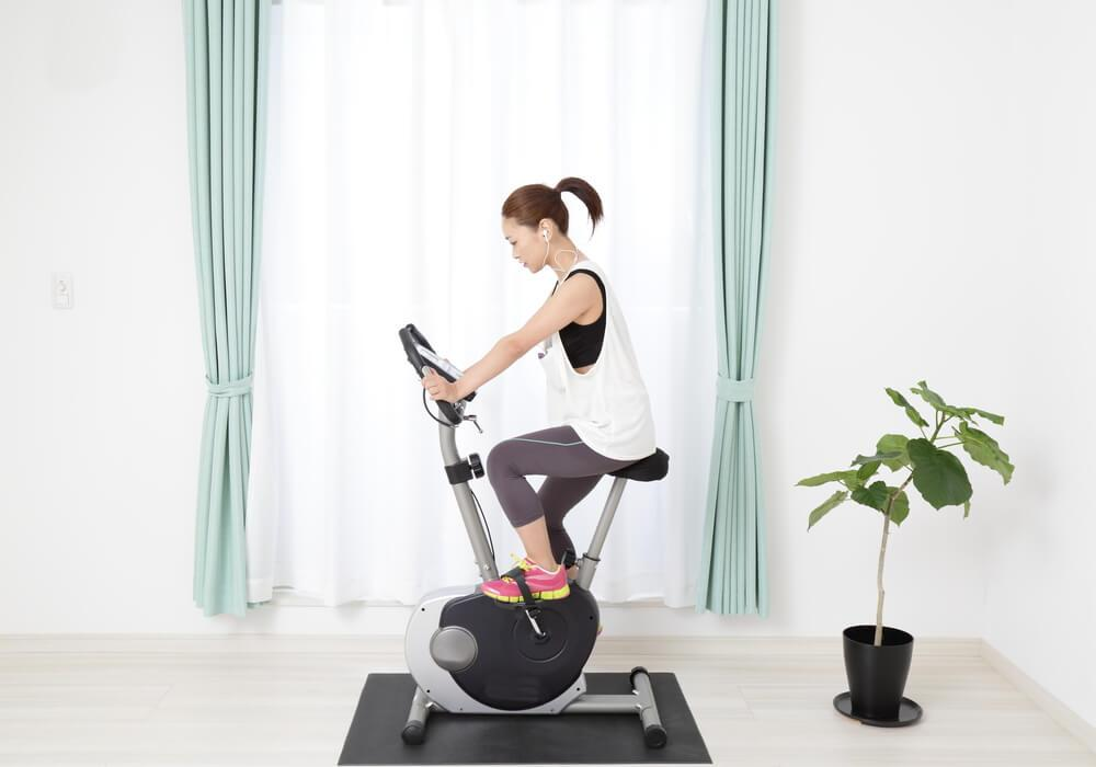 Woman on exercise bike at home