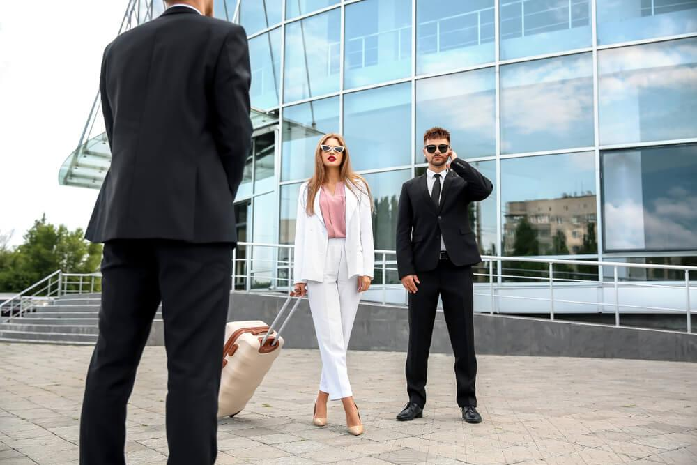 Female celeb at airport with bodyguard